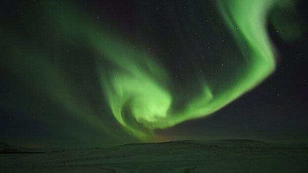 Længere mod nord er nordlyset et noget mere imponerende syn. Billedet her er fra Island.